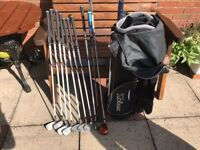 Set of golf clubs with Taylor made driver, bag and trolley