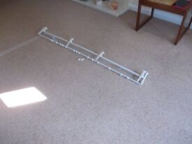 Curtain track with cord to close curtains