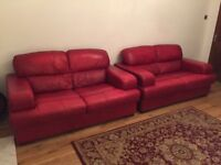 2 Red leather 2 seater sofas