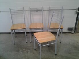 Used. Set of 4 Dining chairs. Can deliver.