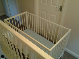 IKEA cot with mattress, been putted together but not slept in at all. without box