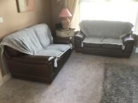 Two two seater settees, leather.