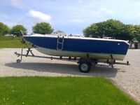 Power Boat on a Galvanized Roller Trailer