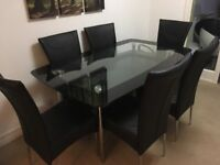 Dining Room Table (Black glass) Harveys Boat