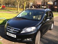 Honda FR-V 2009 black one pervious owner Fully leather nice and clear inside/out