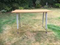 Desk with height adjustable legs