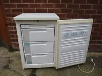 Freezer. 22 inch wide under counter freezer in excellent condition