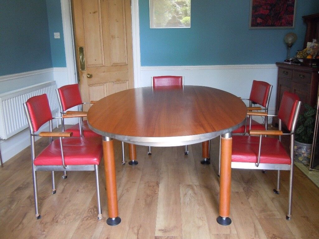 Designer modern oval table and six chairs.