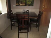 breakfast size table and chairs with black leather seats excellent condition