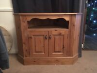 Waxed pine corner tv cabinet . £350 new . Good condition , few marks but nothing serious. Solid pine
