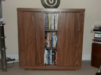"""Next"" DVD and CD storage unit. Brown wood effect. New condition"