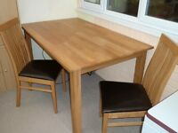 A dining table and 6 chairs.