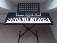 Yamaha YPT 210 Keyboard in very good condition, with adjustable stand and power supply Rarely used.