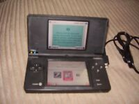 NINTENDO DSI WITH GAMES AND CAMERA