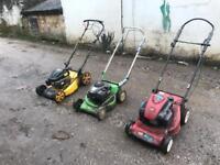 Various petrol lawnmowers