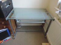 Glass computer desk with pull out shelf for keyboard