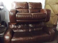 As new. Tan leather 3 and 2 sofas