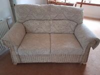 3 piece cane suite with matching coffee table.