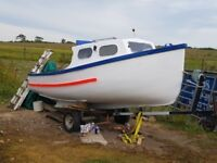 Fishing Sea Boat and launching trailer. Plymouth Pilot 16 ft with 25 hp and an extra 8 hp outboard