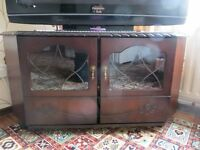 TV stand, dark/mahogany wood, excellent condition.