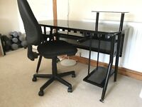 Black glass computer desk (nearly new) and adjustable office chair, (small signs of wear on seat).
