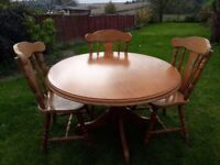 Round solid wood dining table and chairs