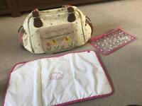 Pink lining blooming gorgeous baby bag with changing mat