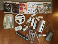 Nintendo Wii with games, controllers and charging station