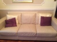 Cream leather three seater sofa and chair