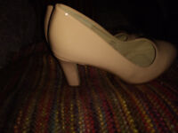 Nude heels wide feet in size 9 and a nude bag