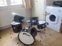 Junior 5 piece drum kit. Tiger brand. Drumsticks and seat included