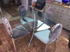 Glass top round dining table & 4 grey/silver chairs