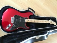 Fender Stratocaster American std, 2005 candy red with original case . As new..