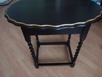 Side/ occasional table in black gloss. with gold rim.