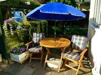 Hexagon wooden table with 4 chairs and parasol
