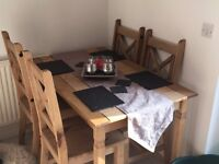 dining table almost new with 4 chairs