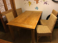 Heavy wooden table and 4 rattan chairs
