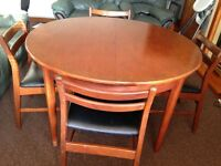 Extendable dining table with 4 chairs-free to collect