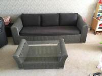 Wicker sofa and coffee table