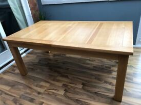 Solid oak extending dining table - seats 16
