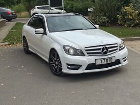 Mercedes Benz C220d Amg line 2012 in stunning white with black panaramic roof.
