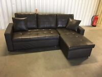 Corner sofa bed - left or right - black leather in good condition // free delivery