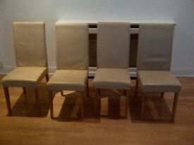 four modern cream leather chairs in very good condition can deliver