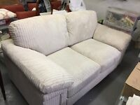 Sofa two seater in beige corduroy together with matching one (1) foot stool with storage