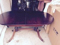 Dining room table and eight chairs.lovely quality mahogany dining room set.chairs are cushioned.