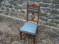 Old chair made from hard wood. Nice for shabby chic paint job