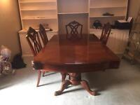 Chippendale style extending dining table with 6 large and comfortable chairs