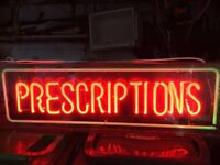 Large retro vintage neon sign 'perscriptions' in a clear case in full working order
