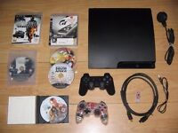 160 GB SONY PLAY STATION 3 PLUS TWO PADS, FEW GAMES AND GAMING CHAIR