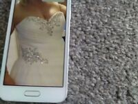 New Wedding dress size 14 will do 12 never worn excellent condition